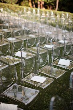 glass and steel wedding on ghost chairs glass