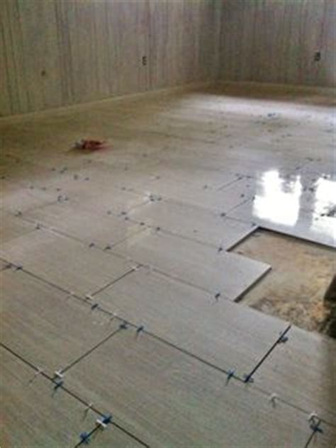 how to lay 12x24 tile 12x24 striated porcelain tile fireplace build wish
