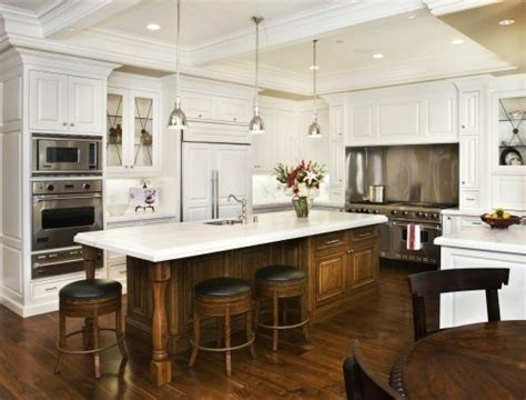 white kitchen wood island quot hearth quot range and side cabinets stained wood 1425
