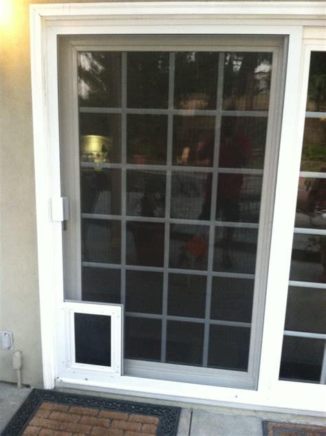 sliding patio screen door with pet door sliding screen door with doors yelp