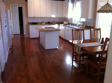 white kitchen wooden floor sweet hardwood gloss white cabinets with small island sink 1426