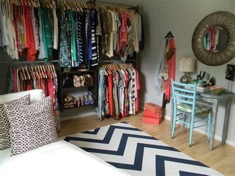 turn a small spare bedroom into a walk in closet