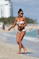 Cassie Ventura strips to her bikini on the beach in Miami ...