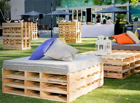 rustic pallet seats  padded top  scattered cushions