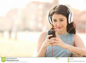 Girl Searching Songs And Listening Music With Headphones ...