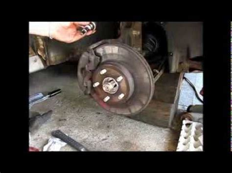 Replacing a front wheel bearing and hub assembly on a 1997 ...