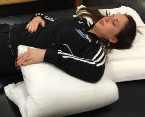Position your pillows to reduce pain for Best sleeping position for shoulder pain