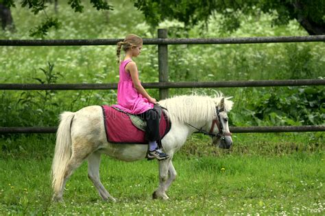 pony riding pink young dress field child children