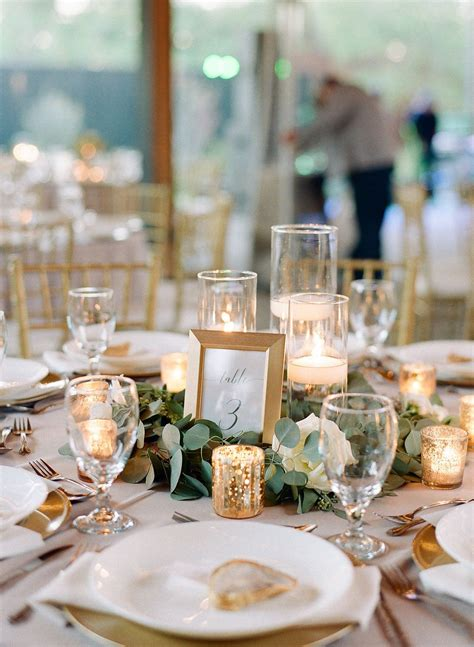 Simple greenery with candles and framed table number