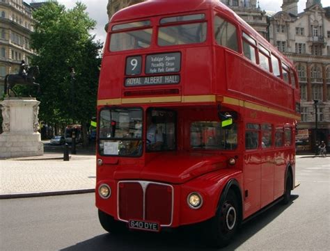 Red Doubledecker Buses Take Tourists On Classic Hopon