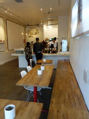 The interior of coffee & tea collective's hq is clinically white and reminiscent of nordic coffee shops, except with a californian. Coffee & Tea Collective - North Park - San Diego, CA | Yelp