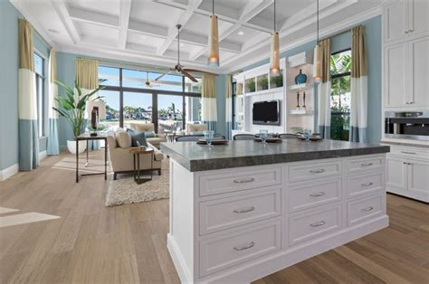 Expansive, Open Kitchen Features Island Done In White