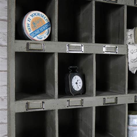 grey wooden pigeon hole shelving unit  drawer storage