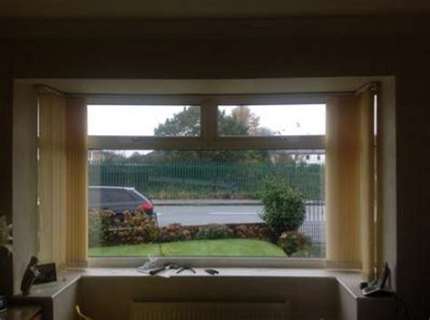 track  square bay window  vertical blinds