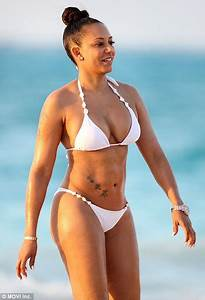 Mel B shows off her washboard abs and ample curves in ...