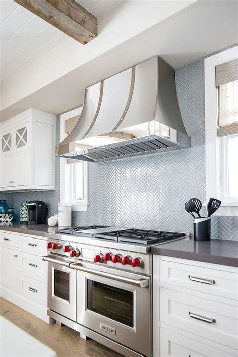 Gray Oval Tiles with Silver and Gold Barrel Range Hood