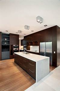 9 kitchens that bine dark wood cabinetry and white countertops 2258