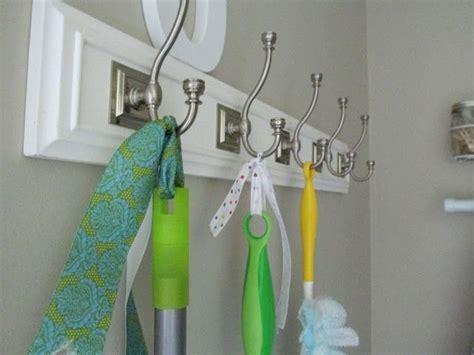 Cute way to hang brooms/mops   Organization   Pinterest