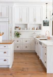 white kitchen furniture white kitchen cabinets with copper cup pulls and copper