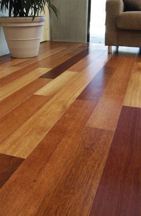 Idea: multicolor hardwoods would match dark baseboard/trim