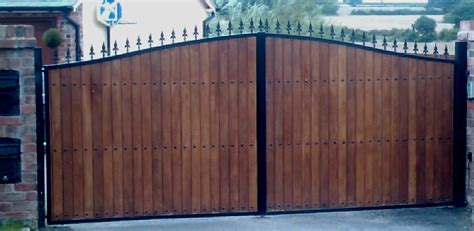 wood and metal gates wooden clad iron gates automation steel framed timber gates