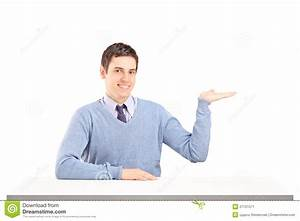 Man Sitting On A Table And Gesturing With His Hand Stock ...