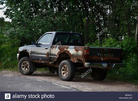 toyota trucks and old rusty junky toyota pickup truck stock photo royalty