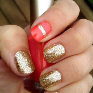 Golden nail polish with one red and stripe