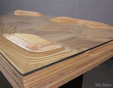 peaks and valleys table inspired by real time topography