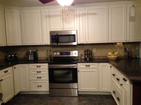 white tile backsplash dark cabinets home design ideas