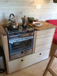handmade tiny house with self built woodstove is home to