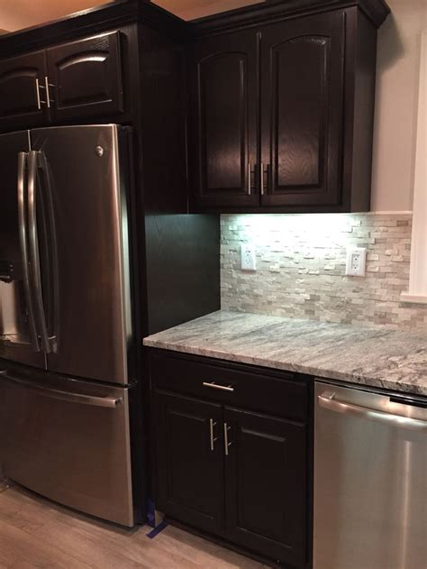 gel stain lowes honey oak cabinets stained with general finishes java gel stain snowflake granite backsplash