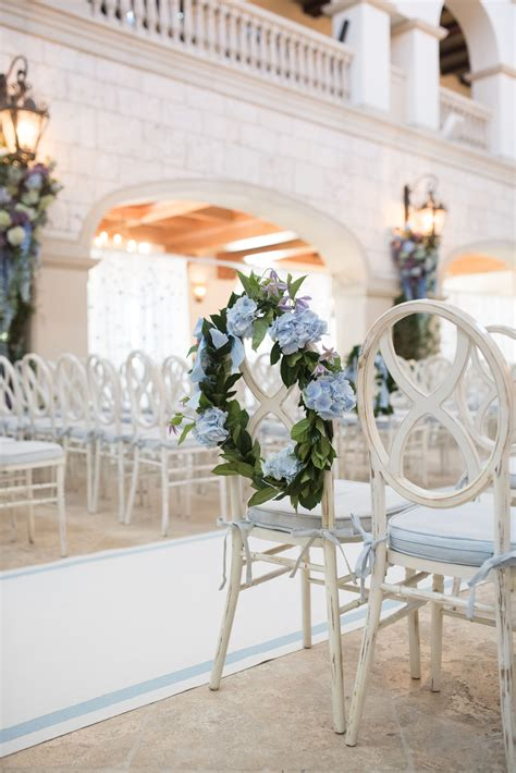 Dress up your ceremony seating with florals on the aisle