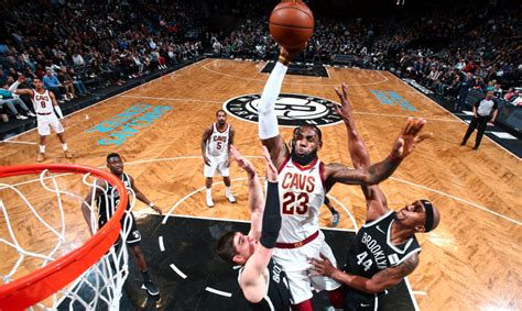 lebron james throws  huge poster dunk  nets video