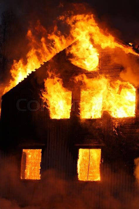 wooden house burning stock photo colourbox