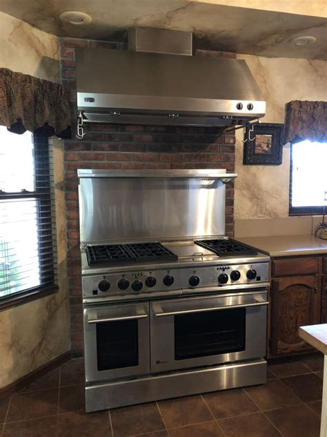 ge monogram  dual fuel professional range  ovens hood  gas burners griddle  electric
