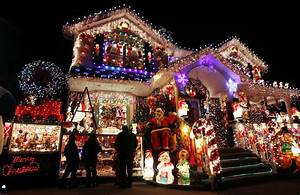 A house is seen decorated with Christmas lights in the ...