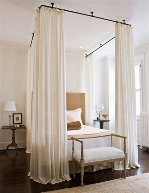pinch pleated drapery panels suspended from an iron rod in