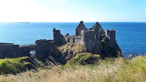 Perched On The Cliff Edge Overlooking The Sea by House Sitting In Northern Ireland Past The Potholes