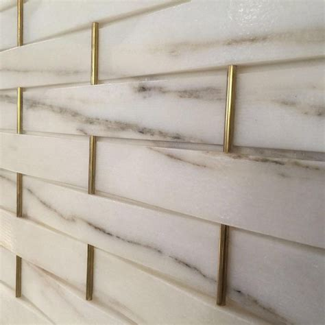 marble wall tiles another great find at salone del mobile today woven marble and brass modern decoration