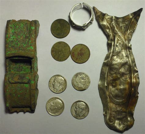 Sterling flatware, old coins, and silver ring - Metal ...