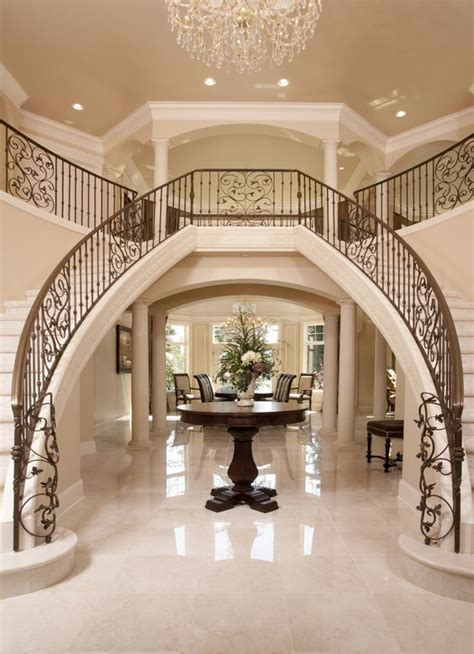 grand foyer luxury iron banister dual staircase grand entryway