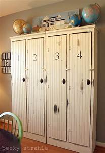 locker styled cupboards use as the entryway room divider