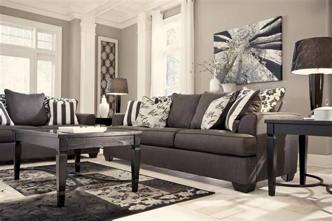 signature design by levon charcoal sofa