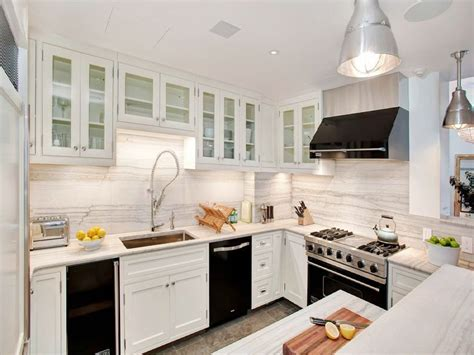 white cabinets and white appliances ugly or pretty white cabinets black appliances cococozy 120 | kitchen%2Bmarble%2Bslab%2Bbacksplash%2Bcounters