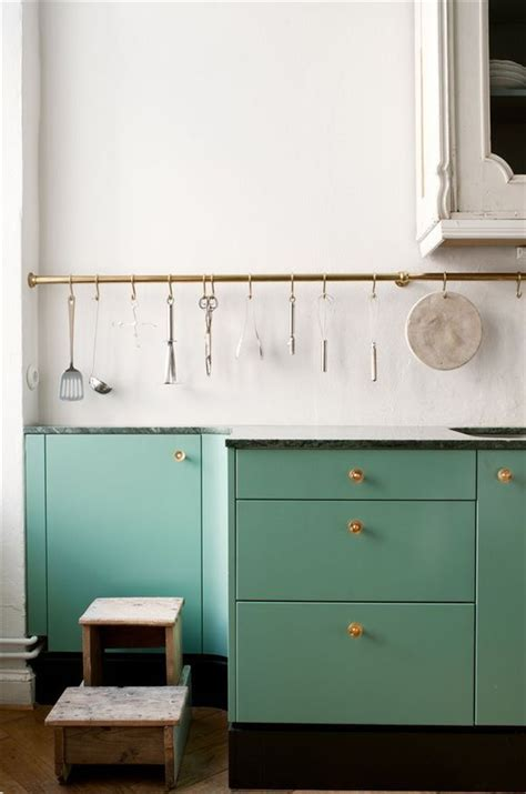 seaglass blue green painted kitchen cabinets  brass