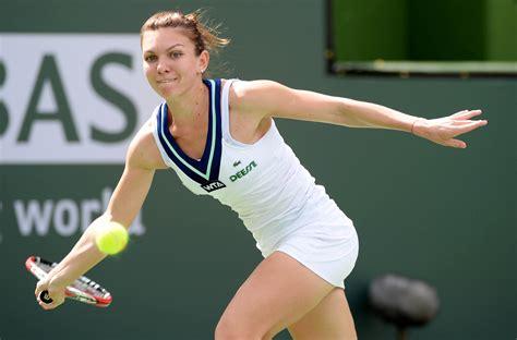 Australian Open -- No. 2 seed Simona Halep falls to Zhang Shuai in first round