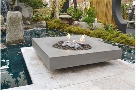 modern zen garden with halo pit by solus