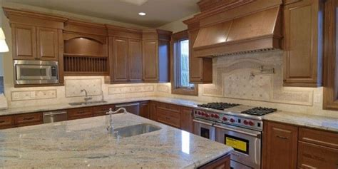 chocolate kitchen cabinets river white granite countertop posted by steve on apr 12 2185