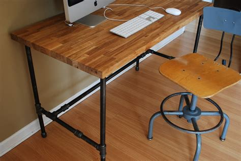 cast iron shelf industrial desk with oak top and steel pipe legs by